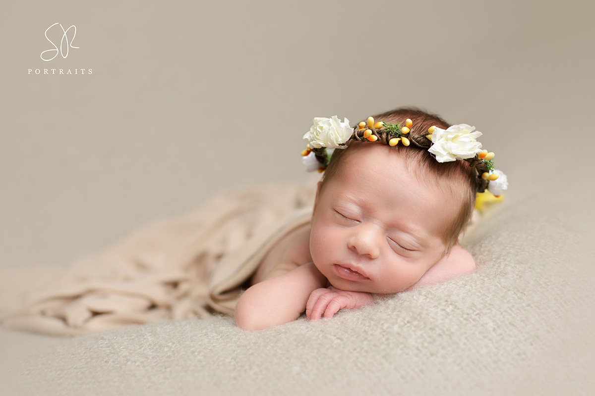 Baby girl on beige blanket. Newborn Photography Nottinghamshire