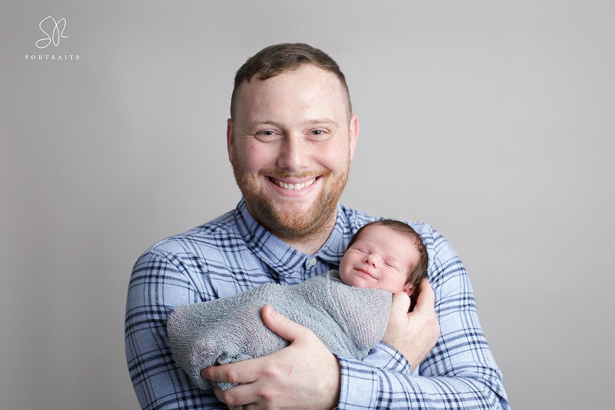 Dad holding newborn baby Coalville Photography