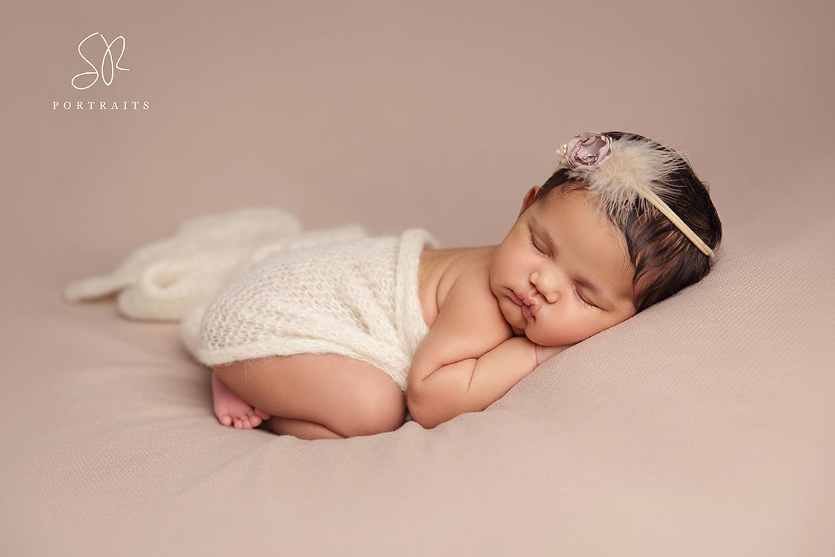 Newborn Photography leicester Newborn baby girl on blanket beanbag